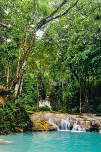 Blue Hole in Ochi is top attraction because jumping and swinging-like-Tarzan from ropes into the refreshing blue pools at the bottom of the falls are other popular activities here.