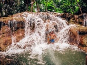 dunns rivel fall ocho rios waterfall is one of the most spectacular waterfalls in Jamaica because it empties directly to the sea.