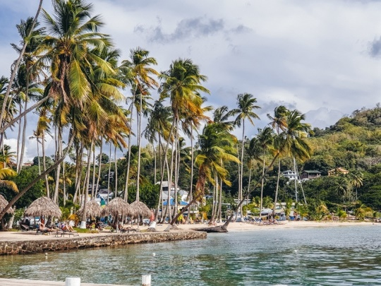 beaches in Saint Lucia: Marigot Bay is a popular beach in Saint Lucia and one of the most picturesque natural harbors in the Caribbean. The classic Caribbean setting with golden sands, swaying coconut palm trees and anchored boats on the bay`s blue waters was also the setting for the original movie Dr. Doolittle.