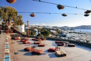 Mykonos 180 Sunset Bar: 180° Sunset Bar is a part of the Mykonos Castle Panigirakis. The best way to reach 180° Sunset Bar is by foot, but be prepared – the road leading to the hidden bar is quite steep. If walking isn`t your thing, you can also drive a car (or ATV). However, the single-lane road is narrow, and you might struggle to find a parking space.