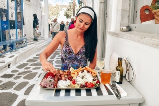 What to do in Mykonos: visit traditional tavernas and try delicious Greek cuisine. Greek meals like souvlaki are very delicious.