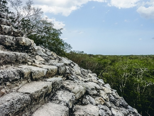 climbing Maya ruins: Climbing the uneven 120 stairs to the top of the main pyramid is well worth the effort. It`s a manageable challenge; unexcavated temple mounds peeking above the trees and the landscape of the jungle canopy are more than enough to keep you thrilled.