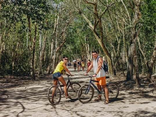 "getting around Coba: There is no shortage of possibilities of how to explore the Coba ruins. You can walk, rent a bicycle, or hire ""a bici taxi"". The budget-friendly cycling is a fantastic experience through the peaceful environment of the surrounding jungle."