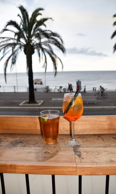 bars in Nice: As the sun sets, make your way to the vibrant beachfront bars on the famous Promenade des Anglais. A wide variety of bars with uninterrupted sea views of the Mediterranean are perfect for watching the sun go down.