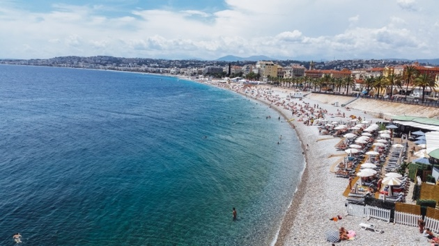 things to do in NIce in France: Beaches are one of top attractions of Nice in France. This famous coastal city has plenty of public and private beaches to choose from. A picture-perfect coast with the legendary blue chairs attracts thousands of travelers every year. However, anyone who is familiar with the city will know that the breeze-cooled beaches in Nice are pebbly. In fact, it is worth noting that all beaches consist of pebbles, and the water gets deep very quickly.
