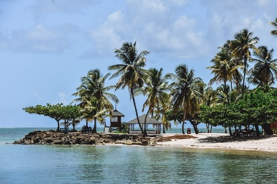Pigeon Point in Tobago - top thing to see in Tobago. . An internationally recognized symbol of the island with soft white sand beach and the swaying coconut trees looks as pretty as a postcard. As well as being romantic, Pigeon Point is steps away from the action.