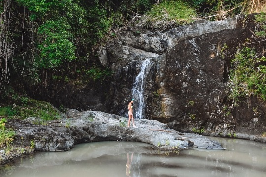 off-the-beaten-path Tobago attractions: cool off in one of waterfalls.