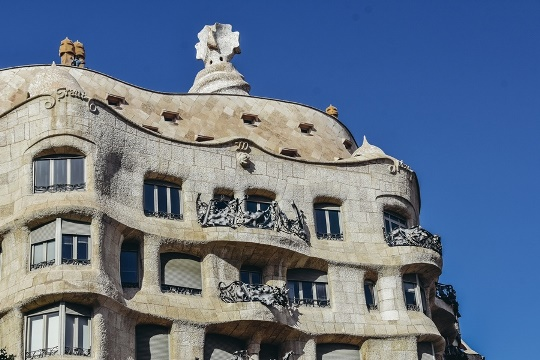 Casa Mila Gaudi`s building in Barcelona: Casa Mila has a curved façade and natural landscape. It`s Antoni Gaudi's most famous house, because it is a masterpiece with the irregularities of the natural world.