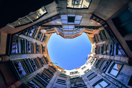 Casa Mila in Barcelona consists of two buildings which are linked by courtyards. The locals loved and hated this private home of a wealthy Mila family during the construction. It was due to its unusual style.