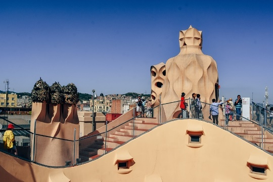 Casa Mila Gauidi building in Barcelona: Gaudi's last residential project is one of the most famous buildings in Barcelona. The iconic roof terrace with stairwells connecting the attic and ventilation shafts offers stunning views.