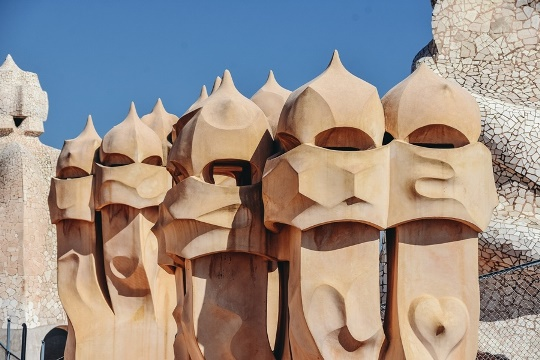 Gaudi attractions in Barcelona: Casa Mila is an extraordinary piece of art. The highlight of the house is a roof terrace with chimneys that appear like helmeted soldiers.