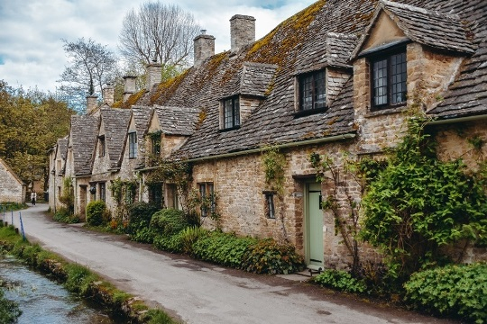 "Cotswolds villages: Bibury is a must-see village in the Cotswolds because it is undoubtedly one of the loveliest Cotswolds villages. Bibury is perhaps best-known for ""Arlington Row"" with a line of preserved 17-th century weaver`s cottages."