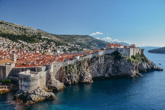 things to do in Dubrovnik, Croatia: Dubrovnik city walls are one of the best things to do in Dubrovnik because the are overlooking the sea and provide some of the best views of the Old Town. Also, they are dotted by fortresses and towers.