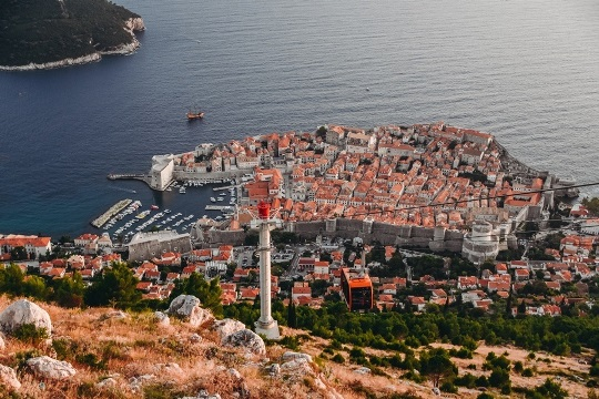 best things to do in Dubrovnik: take a cable car to Mount Srd because it allows you to see scenic views of Lokrum island and the Old town. If you want to watch the sunset, this is the place to be.