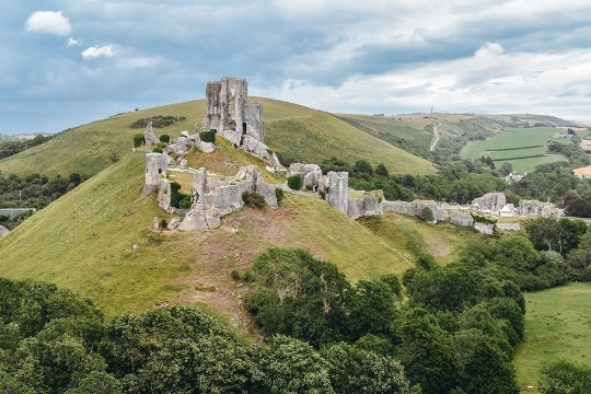 things to do in Dorset: Corfe Castle, one of Dorset`s most famous landmarks, is also one of Britain's most iconic survivors of the English Civil War. Moreover, Corfe Castle is thought to be one of the first castles built in England.