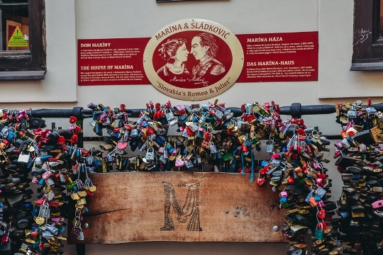 Couples in love come to Stiavnica to padlock their lock of love on the iron bars of Marina`s house.