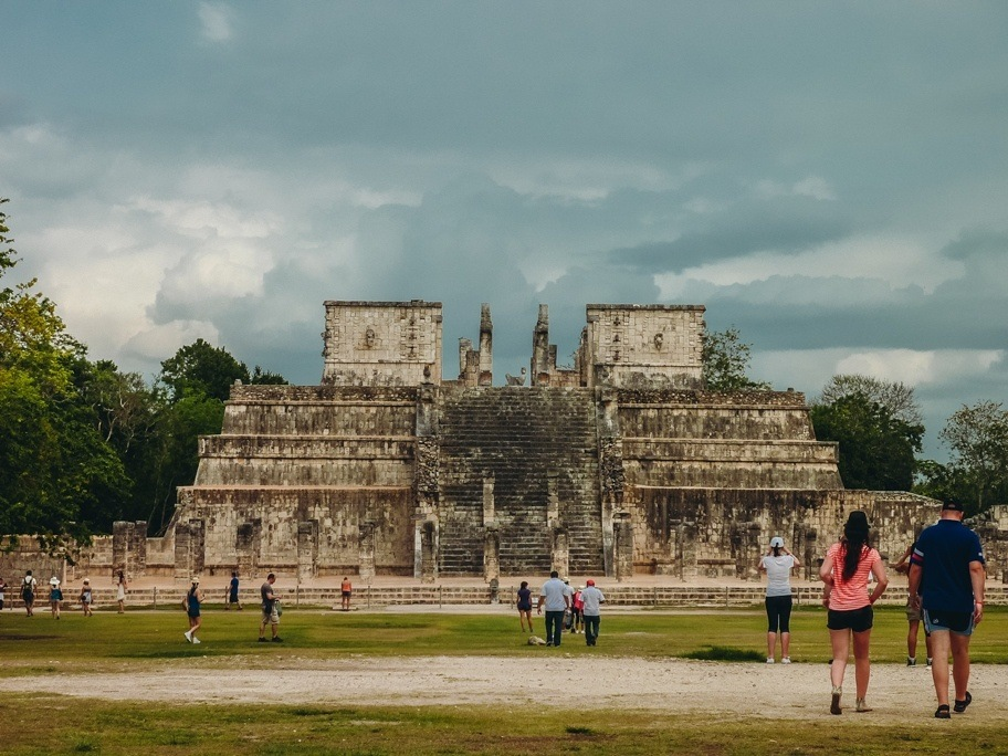 Temple of the Warrior is one of the most impressive structures in Chichen Itza in Mexico. This pyramid structure with a central stairway and a sculpture at the top consists of four platforms. On a side and at the front you can see more than 200 stone columns – they`re Maya warriors protecting this sacred place.