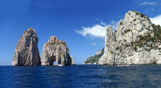 Faraglioni rocks are another place you want to see from the boat. This massive rock formation not only symbolizes Capri island, and it's also home to a variety of rare wildlife.