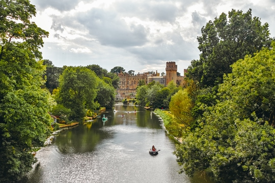things to do in Warwick: Seeing Warwick Castle from the river is one of the fun things to do in Warwick. It allows you to see the magnificent castle from a different angle while relaxing and enjoying the beautiful scenery.