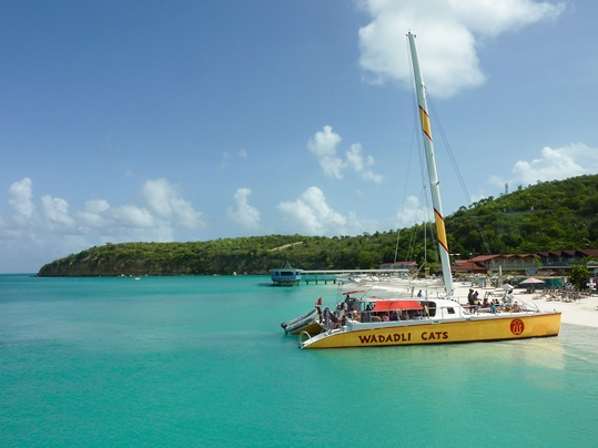 things to do in Antigua and Barbuda: Sail along Antigua's 365 beaches, and admire the island's beautiful coastline. A catamaran day trip around the island is one of the top things to do in Antigua and Barbuda, because it allows you to see the island from the water, but you can also visit secluded places you would never find on your own.