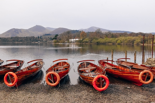 Lakes in the Lake District: A short stroll from historic Keswick town will bring you to one of the largest lakes in the Lake District – Derwent Water. Spend a couple of hours exploring to see everything this lake surrounded by hills offers. Keswick Launches, which operate regularly around ''Keswick's Lake'', are for many visitors one of the best attractions in the Lake District. Alternatively, walk the lakeshore paths, which offer stunning views of the lake.