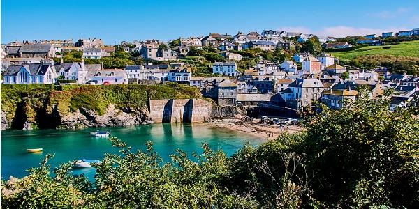 places to visit in Cornwall: It is no surprise that exploring tranquil Port Isaac is one of the popular places to visit in Cornwall during the summer. This tiny fishing village in Cornwall has the scenic harbour and pier built during the time of Henry VIII. Besides, Port Isaac is dotted with white-washed cottages and offers beautiful seaside views.