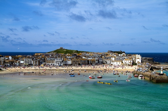 Places to visit in Cornwall: St Ives is one of the most popular destinations in Cornwall - and it is easy to see why. An idyllic seaside town with a thriving harbour, excellent restaurants is also home to artist studios and independent galleries. Also, St Ives is famous for its beautiful beaches - they are some of the best in Cornwall. Therefore, St Ives is an unmissable place to visit in Cornwall.