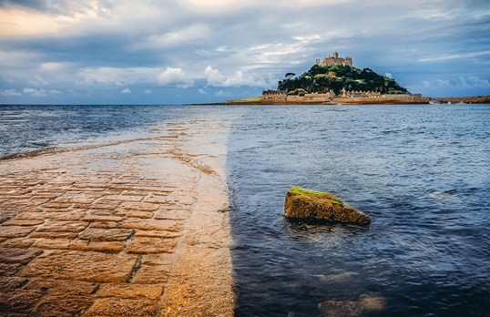 places to visit in Cornwall: The St Michael's Mount is one of the unique places to visit in Cornwall because this magical castle sits in the middle of the water. It is a tidal island connected to the land at low tide. Therefore, a visit to St Michael's Mount is one of the best things to do in Cornwall.
