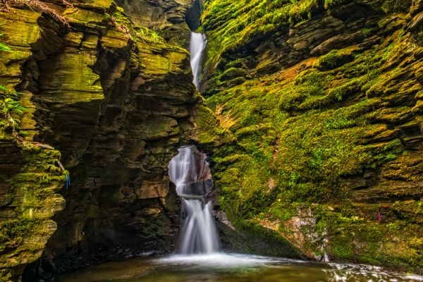 places to visit in Cornwall: If you are looking for unique attractions in Cornwall, St Nectan's Glen is one of them. St Nectan's Glen a tranquil place stretching along both banks of the Trevillet River. This ancient woodland is home to a spectacular 60 foot (18 metres) waterfall that splashes through a hole in the rocks. St Nectans Glen is undoubtedly one of the most gorgeous places to visit in Cornwall.