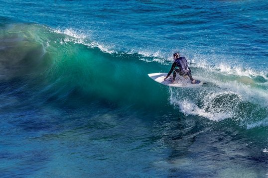 Try your hand at surfing and hit the waves on one of the famous beaches. Don't worry if you do not know how to surf – Newquay is one of the best places you can learn to surf in England. It has plenty of surf schools, and you can also find here beaches that suit surfers of every level.