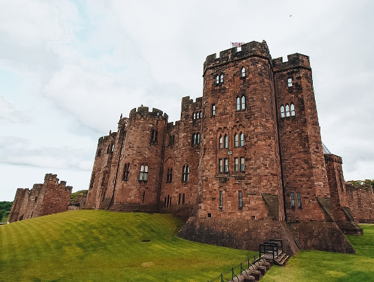 best castles in England: Alnwick Castle makes an ideal getaway in Northumberland. Alnwick Castle is one of the best castles in England because it is beautifully preserved, has extensive grounds, and it has one of the finest collections of paintings in England. Also, Alnwick Castle is the second largest inhabited castle in England.