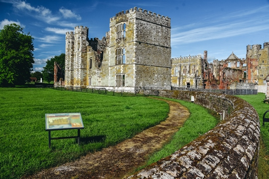 Best Castles in England: Cowdray Castle in West Sussex is one of the best castles in England because it was once one of the finest buildings in England. It may not be a castle, but it is one of the most impressive English Tudor Houses.