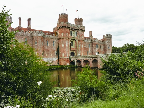 castles in England: Herstmonceux Castle is one of the best castles in England. This 15th-century moated castle is unique for its red brick design. The two-storey castle is famous for being one of the oldest brick buildings still standing in England. Also, the castle never saw battle or siege - it was originally a manor house.
