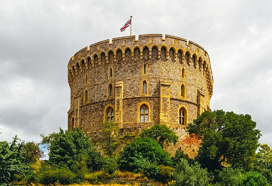 Many tourists wonder when the Queen is in Windsor. If the Royal Standard is flying from the tower, then she is. If the Union Flag is, then she is not in residence.