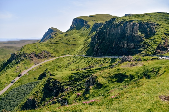 places to visit in Isle of Skye: Quiraing in the north of the island is one of the best Isle of Skye attractions. This wonderland of natural beauty is made up of soaring cliffs, rock pinnacles and beautiful plateaus. Rolling hills and striking landscape make Quiraing one of the best places to visit in the Isle of Skye.