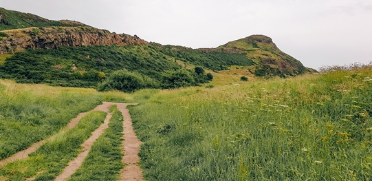 places to visit in Edinburgh: Walking Arthur's Seat is one of the popular places to visit in Edinburgh because it offers perfect views of the city. Hiking up to the ancient volcano is relatively easy – it takes about 45 minutes to get to the top. You can choose from different trails depending on the level of difficulty you prefer.